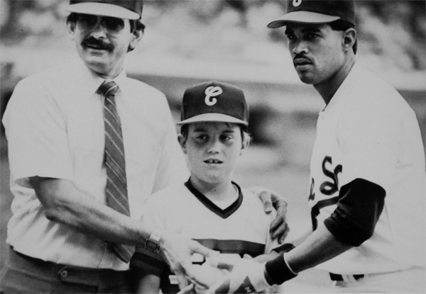 History professor Matt Hinckley, center, poses with his dad, left, with Ozzie Guillen, right, before an 1987 White Sox game.