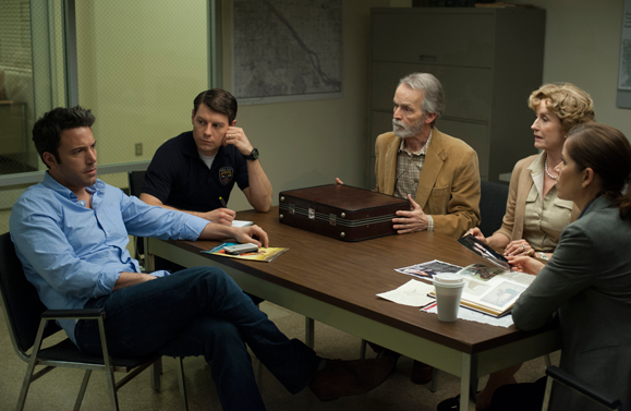 """In a scene from """"gone Girl,"""" Ben Affleck (far left) is questioned by police about the disappearance of his wife as his in-laws look on."""