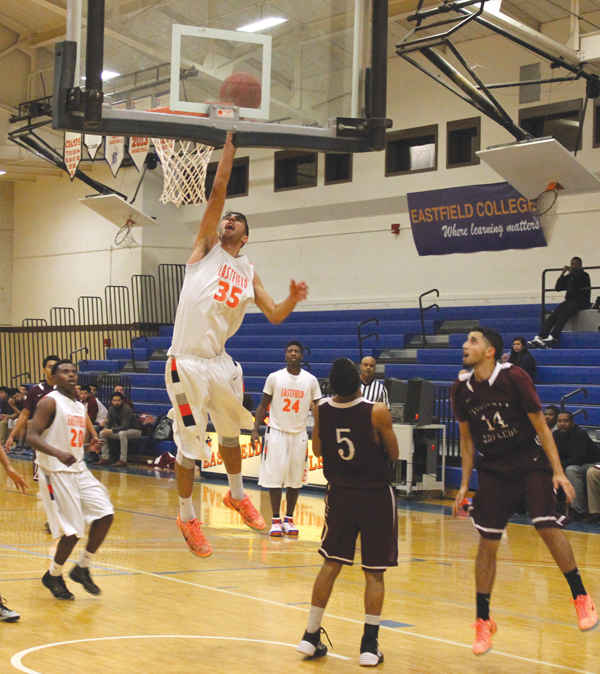 GUILLERMO MARTINEZ/THE ET CETERA Freshman forward Youssef Kaoud tips a basket in the Harveters' 127-97 victory against Victoria College on Nov. 7. Eastfield defeated Victoria again the following day.