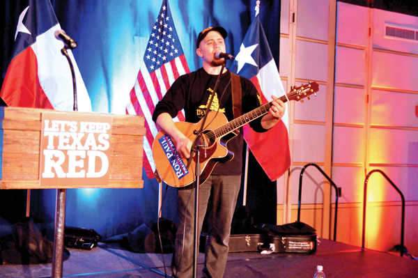 GUILLERMO MARTINEZ/THE ET CETERA Jordan Page performs for the Republican watch party at the Dallas Arboretum on election night Nov. 4.