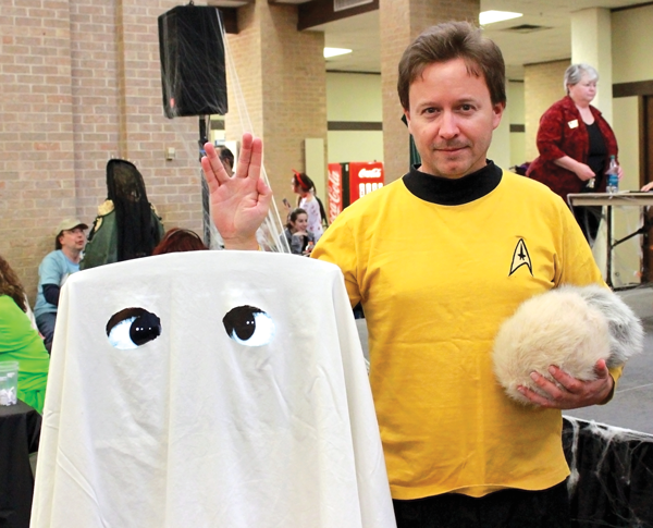 PHOTOS BY BRAULIO TELLEZ/THE ET CETERA Above, Professor David Kirk and the Kirkatron attend Eastfield's Halloween bash last month. Right, the Kirkatron is unmasked.