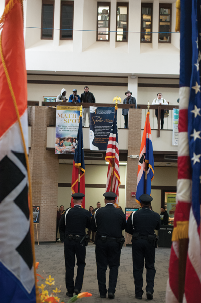 BRAULIO TELLEZ/THE ET CETERA From left, Officer Philip Wilburn, Sgt. Brandon Boney and Sgt. Kevin Levingston present the flags at the Veterans Day ceremony Nov. 11.