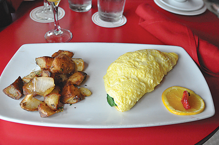 The omelette provencale from Toulouse Café and Bar is served with herbed potatoes. Photo by Courtney Schwing/The Et Cetera.