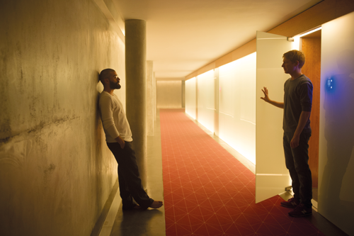"""Nathan (Oscar Isaac) and Caleb (Domhall Gleeson) in a scene from """"Ex Machina."""" Photo Courtesy A24 Productions."""