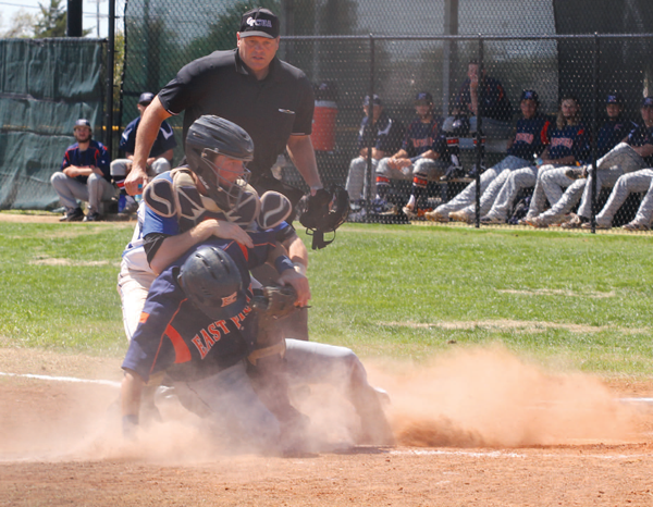 Freshman shortstop Casey Maack slides into home plate against Mountain View. Photo by Jonathan Wences/The Et Cetera