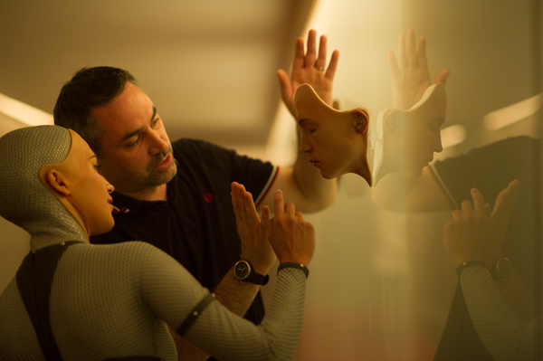 """Ex Machina"" director Alex Garland helps Alicia Vikander, who plays the cyborg Ava, prepare for a scene. Photo Courtesy A24 Productions."