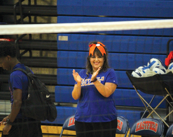 BRIANNA HARMON/THE ET CETERA History professor Kat Reguero cheers on the volleyball team while serving as guest coach in the conference opener against Brookhaven on Sept. 22.