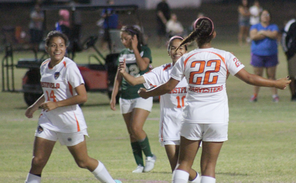Karla Gutierrez, Elizabeth Cobar and Miriam Mendoza celebrate after one of Eastfield's four goals against Richland on Oct. 13.  PHOTO BY DAVID SANCHEZ/THE ET CETERA