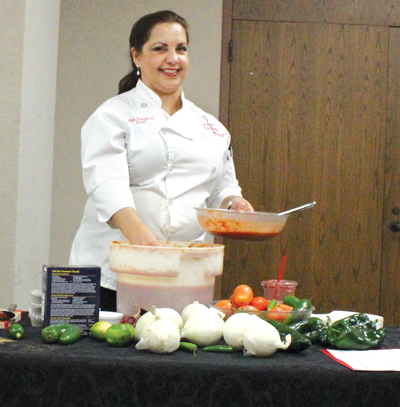 Chef Lydia Gonzalez of the Addison restaurant Savorista prepares fresh salsa during a cooking demonstration Oct. 21. PHOTO BY GUILLERMO MARTINEZ/THE ET CETERA