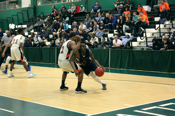 Eastfield's Ed Williams drives around a Nassau defender on his way to the basket. PHOTO BY BRIANNA HARMON/THE ET CETERA
