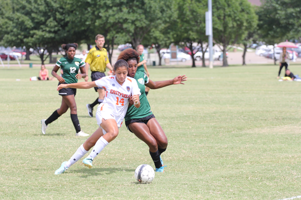 James Hartley/The Et Cetera Karla Gutierrez blocks a defender in Eastfield Soccer's Sept. 13 game