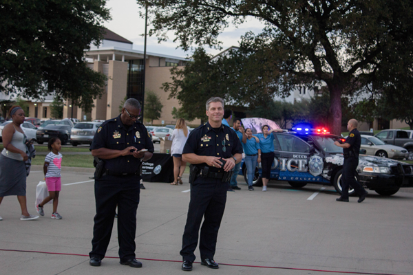 Captain Timothy Ellington (left) and Chief Michael Horak of the Eastfied Police attend National Night Out on campus. Photo by Jonathan Wences/The Et Cetera