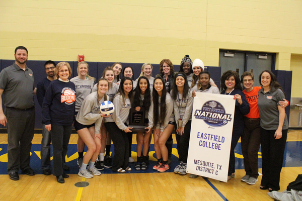 The Eastfield volleyball team shows off their plaque. Photo by Brianna Harmon/The Et Cetera