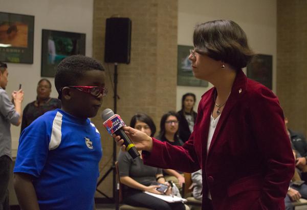 Cindy Casteneda interviews people at the Nov. 8 2016 election night watch party. Photo by Jasmin Jimenez.