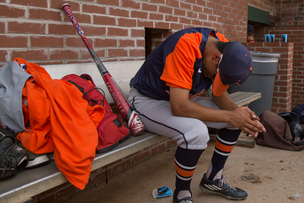 Joseph Sanchez cries in the Harvester dugout after a 10-6 loss against the Brookhaven Bears ended the team's season. This season was Sanchez's second and final year with Eastfield. Photo by James Hartley/The Et Cetera