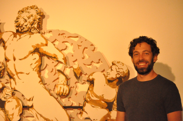 Artist Ryder Richards shows off his piece 'Connected: Laacoon.'