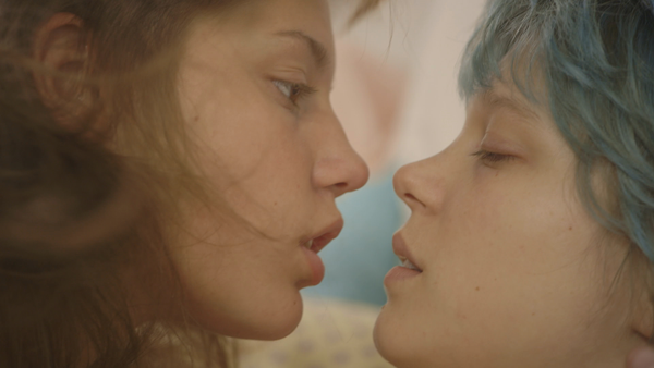 Adele and Emma share a kiss in the film 'Blue is the Warmest Colour.'