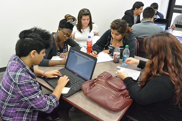 Students from Dallas' Samuell High School work during a recent study hall. About 100 high schoolers attend Eastfield, working toward simultaneous high school and associate's degrees.