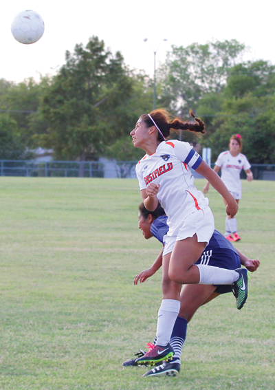 JONATHAN WENCES/THE ET CETERA Liliana Cardozo heads the ball past a defender in a 0-0 tie against North Lake on Oct. 10 at home.
