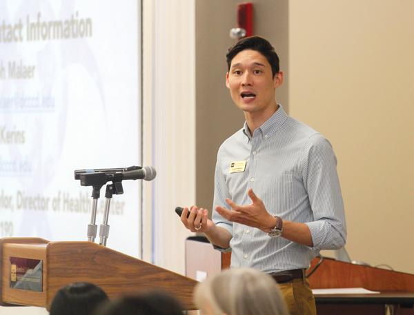 JONATHAN WENCES/THE ET CETERA Biology professor Joseph Malaer debunks Ebola myths with facts at a STEM seminar.