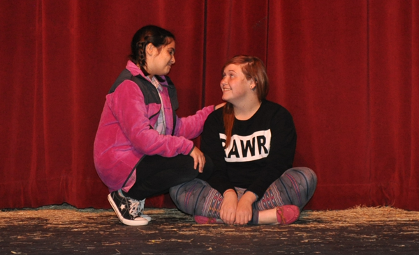 SIDNEY MURILLO/THE ET CETERA Fern Arable, played by Olivia Hester, befriends a small piglet named Wilbur, played by Ashley Vessells.