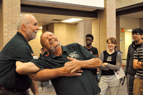 Representatives of Self Defense America of Mesquite demonstrate self-defense techniques at Eastfields Its on Us event Oct. 23.