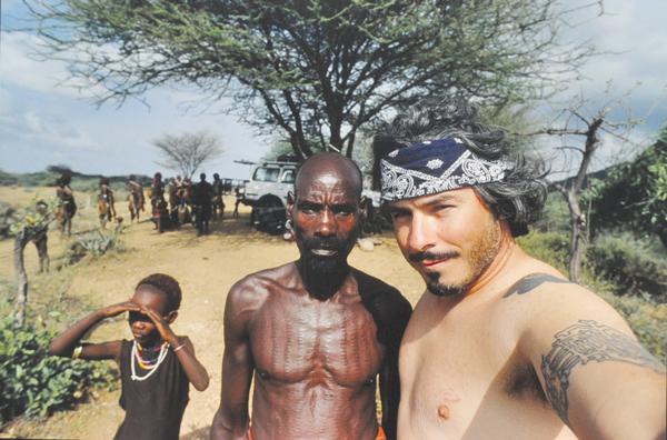 Krutak with a Hamar warrior in Ethiopia. (Photo by Lars Krutak)