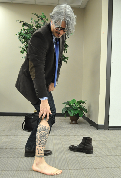 Lars Krutak reveals one his many tattoos after speaking Nov. 20 at Eastfield (Photo by Braulio Tellez)