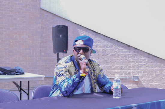 Rico Love speaks words of inspiration and encourages students to value their education. Photo by James Hartley/The Et Cetera.