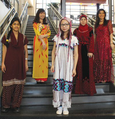 Representing cultural fashion left to right is Angelin Jameson representing India, international student Lily Nguyen representing Vietnam, Paw Day for Thailand, Fatn Fuad wearing traditional garb from Palestine, and Leyla Mohamadyar shows off an Iranian dress. Photo by Ana Gallegos/The Et Cetera.