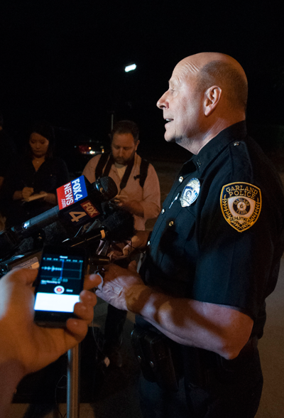 Joe Harn, Garland police spokesman, briefs reporters May 3 outside the Culwell Center in Garland following a fatal shooting.