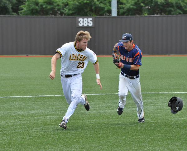 Eastfield shortstop Casey Maack chases Tyler Junior College's Zane Otten after Otten overslid second base and was forced to run for third in the team's first National Junior College Athletic Association District C Tournament matchup May 17. Maack caught up and tagged Otten out. Photo by James Hartley/The Et Cetera