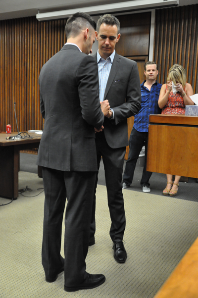 David Telfer, left, and Sean Williamson exchange rings as they are married Friday at the George Allen Sr. Courts Building in Dallas. (Photo by Ana Gallegos/The Et Cetera)
