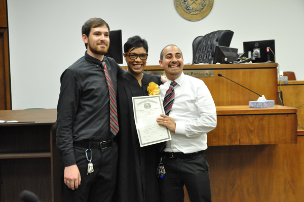 Austin (left) and Joshua celebrate their mariage with Judge Dominique Collins in the George Allen Sr. Courts Building. They had not decided on a shared last name. (Photo by Anna Gallegos/The Et Cetera)