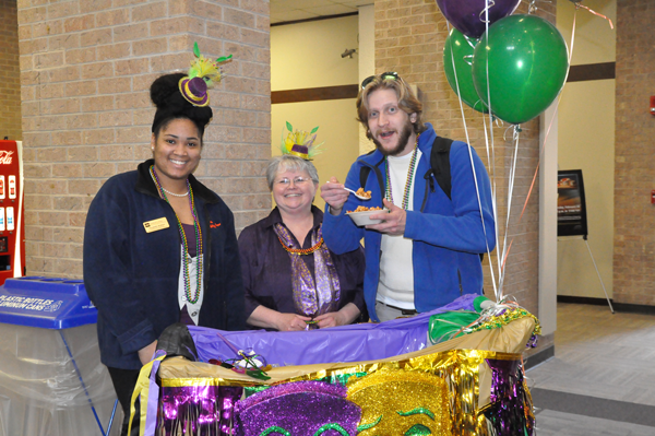 Judy Schwartz, former director of Student Life, celebrates Mardi Gras in February with clubs coordinator Unswella Ankton and student Michael Heggie. Photo by Ana Gallegos/The EtCetera