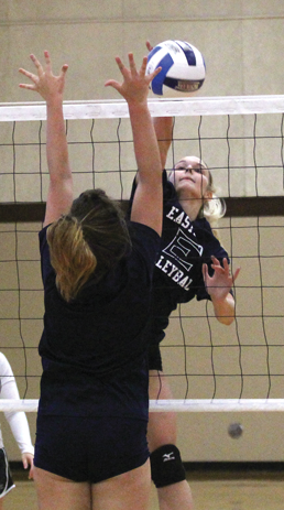 Megan Murphy rises for a kill at a recent practice. Photo by James Hartley
