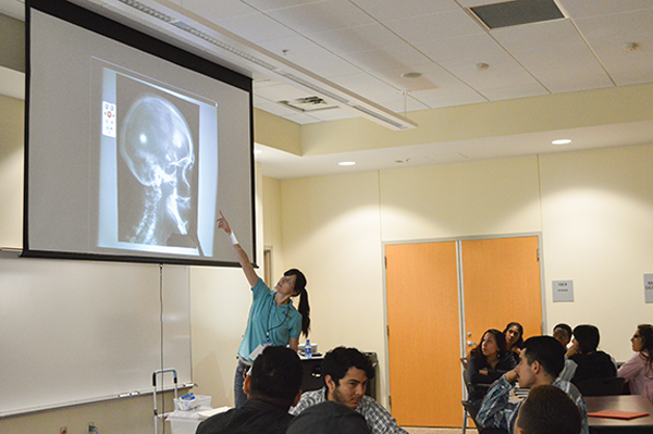 Jessie Crowley of the Perot Museum speaks to students at the Pleasant Grove campus.