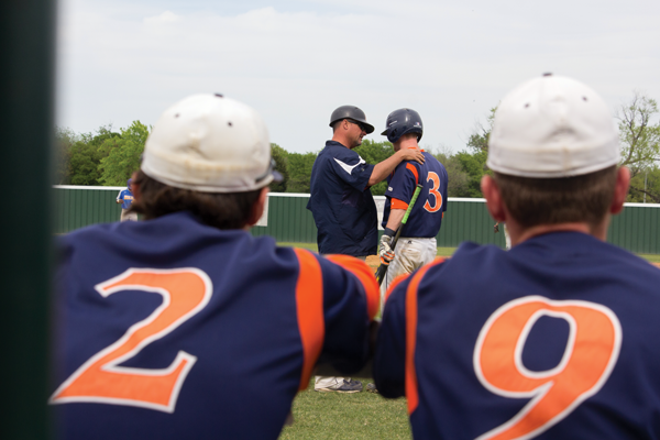 Coach Michael Martin talks to sophomore infielder Trey Stone during an April 8 game against Mountain View College. PHOTO BY JONATHAN WENCES/THE ET CETERA.