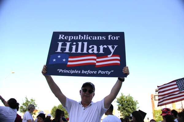 """James Hartley/The Et Cetera John Aholloran, a lifelong republican, says he is voting for presumptive Democratic nominee Hillary Clinton because he is """"disgusted"""" by Trump's hateful comments about hispanics and Muslims."""