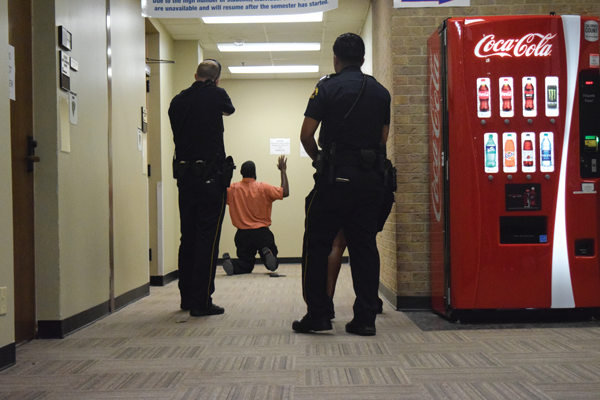 Police move in to make the arrest in their lockdown scenario drill. Photo by Andrew Gonzales/The Et Cetera