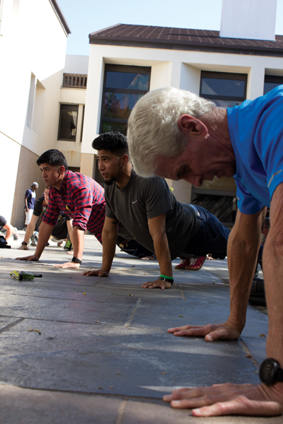 Students prepare to begin the 22 pushup challenge. Photo by David Sanchez/The Et Cetera