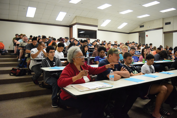Students pack a classroom to voice their opinions on Texas' controversial voter ID law. The interactive panel is one of many campus events leading up to the election. Photo by Andrew Gonzales/The Et Cetera