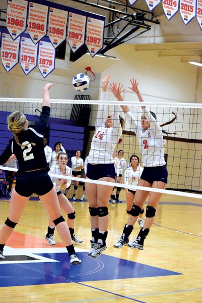 Faith Faulkner and Alyssa Tomlin go up to block during the Oct. 10 win over Mountain View. The Harvesters defeated the Lions 3-0 (25-9, 25-15, 25-18) Photo by Andrew Gonzales/The Et Cetera