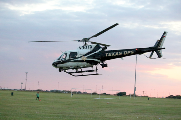A Department of Public Safety helicopter takes off from the Eastfield soccer fields after visiting campus for National Night Out. Photo by Ahmad Ashor/The Et Cetera