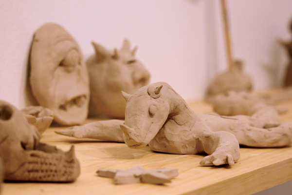Visitor-made clay sculptures sit on a display table at the end of the gallery. Photo by Ahmad Ashor/The Et Cetera.