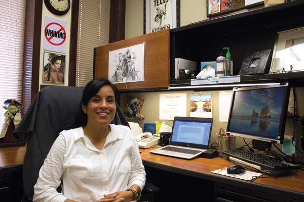 Kassandra Buck, English professor, sits in her office decorated with Star Wars posters and memorabilia. Photo by David Sanchez/The Et Cetera