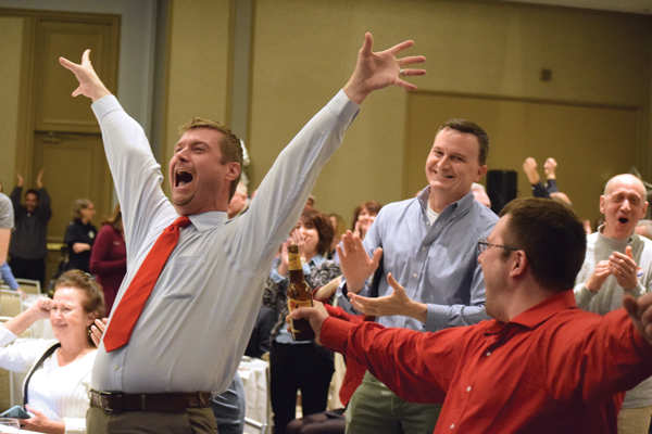 Trump supporters Brett Cummins and Van Freeman, both of Dallas, react to Ohio selecting the Republican presidential candidate. Photo by Andrew Gonzales/The Et Cetera