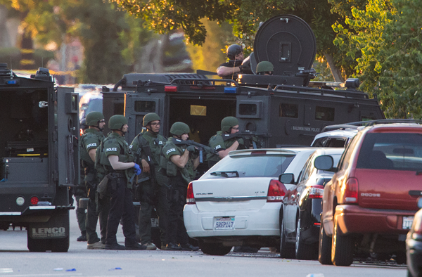 SWAT officers on scene at the intersection of Orange Avenue and Fourth Street after 4 people were shot in Azusa, Calif., on Tuesday, Nov. 8, 2016. (Gina Ferazzi/Los Angeles Times/TNS)