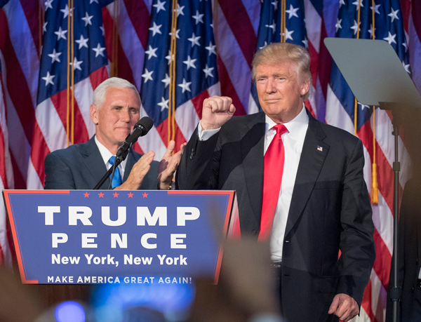 J. Conrad Williams Jr./Newsday/TNS President-elect Donald Trump pumps his fist, with running mate Mike Pence standing by, following his victory speech. Photo by J. Conrad Williams Jr./Newsday via TNS