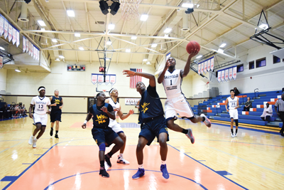 D'Angelo Streeter leaps for a layup in the Harvesters 141-74 win over Paul Quinn College on Nov. 4. Photo by Andrew Gonzales.